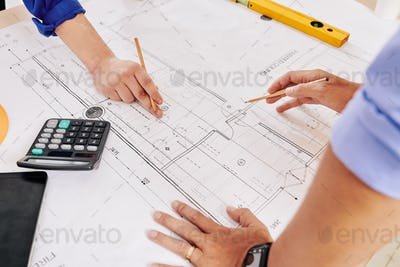 Architects working on building plan