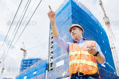 Frowning contractor at construction site