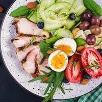 Ketogenic diet. Buddha bowl dish with meatloaf, chicken meat, avocado, berries and nuts.