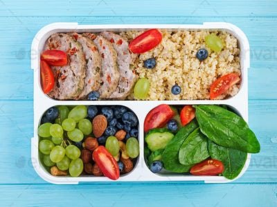 Lunch box  meatloaf, bulgur, nuts, cucumber  and berry. Healthy fitness food. Take away. Lunchbox.
