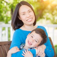 Outdoor Portrait of Chinese Mother with Her Mixed Race Chinese and Caucasian Young Boy