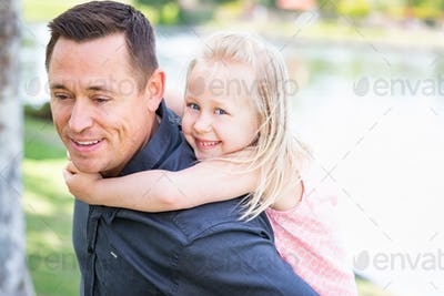 Young Caucasian Father and Daughter Having Fun At The Park.