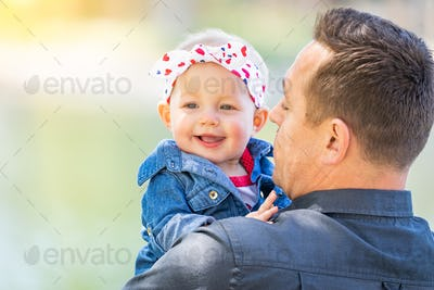 Young Caucasian Father and Baby Girl At The Park.