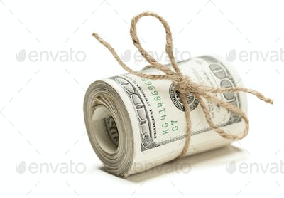 Roll of One Hundred Dollar Bills Tied in Burlap String Isolated on a White Background.