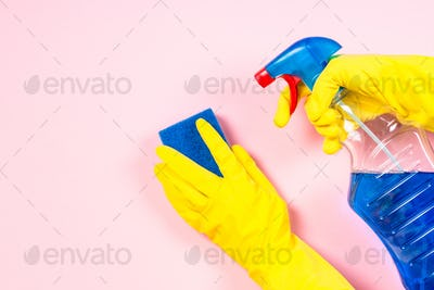 Woman cleaning pink surface