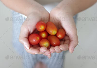 Girl holding the cherry tomatoes