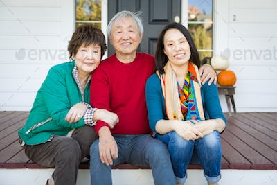 Happy Chinese Senior Adult Mother and Father with Young Adult Daughter Portrait