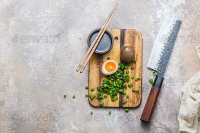 Marinated egg nitamago on cutting board, copy space