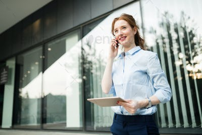 Business woman speaking cellphone during a work day