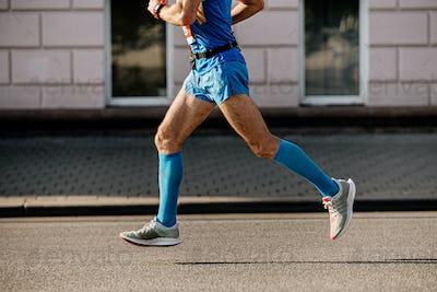 athlete runner in blue compression socks