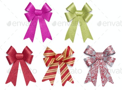 Set of Five Multicolored Glitter Bows and Ribbons on White Background.