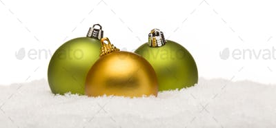 Beautiful Green and Yellow Christmas Ornaments on Snow Flakes Isolated on a White Background.