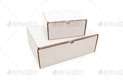 Stack of Blank White Cardboard Boxes Isolated on a White Background.