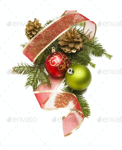 Christmas Ornaments, Golden Pine Cones, Red Ribbon and Pine Branches Isolated on a White Background.