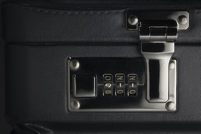 Briefcase Abstract with the Numbers 911 on Lock.