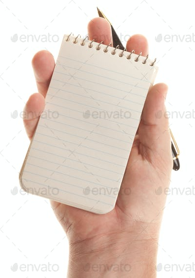 Male Hands Holding Pen and Pad of Paper Isolated on a White Background.