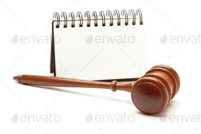Blank Spiral Note Pad and Gavel Isolated on White.