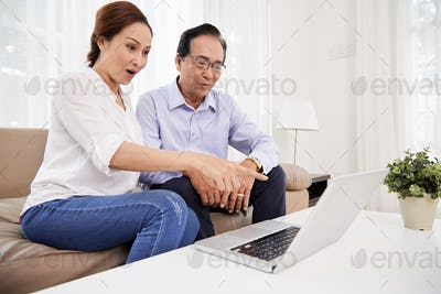 Aged couple watching videos