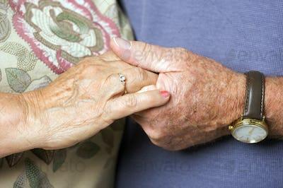 Senior Adult Couple Holding Hands