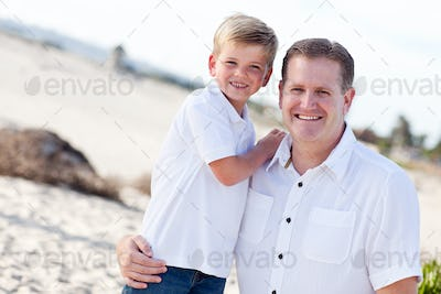 Cute Son with His Handsome Dad Portrait at The Beach.