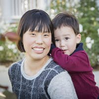 Happy Chinese Mother Having Fun with Her Mixed Race Baby Son.