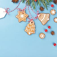 Christmas Gingerbread Cookies with Paper Tag on Blue Background.