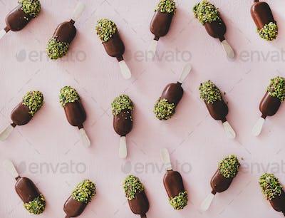 Chocolate glazed ice cream pops with pistachio icing pattern