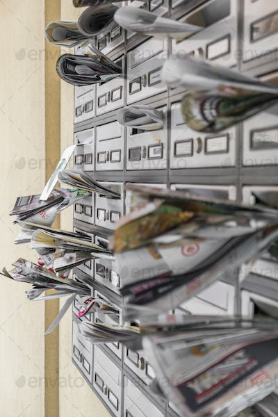 Mail boxes filled of leaflets