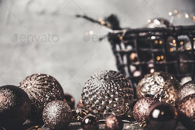 vintage christmas, new Year toys and decoration in basket on brown wooden table, copy space