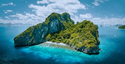 Aerial drone panorama picture of tropical paradise epic Entalula Island. Karst limestone rocky