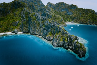 Miniloc Island with limestone cliffs. Aerial drone panoramic picture. Bacuit Archipelago, El Nido