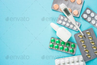 Tablets and medicines on a blue background