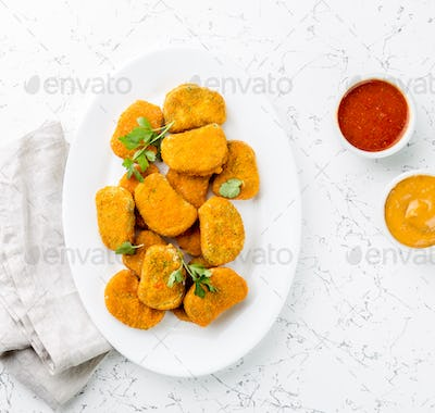 Healthy vegetarian nuggets with carrots, cauliflower and spinach