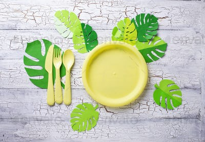 Summer party table setting with yellow dishes