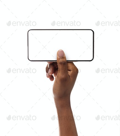 Smartphone with blank screen in horizontal orientation in female hands
