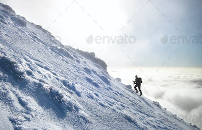 Mountain Climber Above the Clouds in New Zealand
