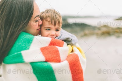 Mother and Son Hugging at the Beach