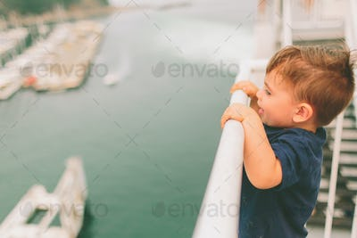 Little Boy Looking Over Railing