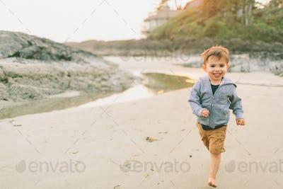 Happy Boy Running on the Beach