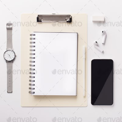 Cellphone with black blank space and notebook for text on white