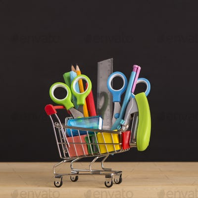 Close up of shopping cart with school stationery for sale