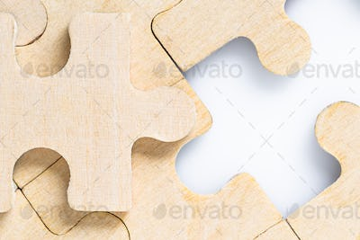 Missing jigsaw puzzle pieces on white_-11