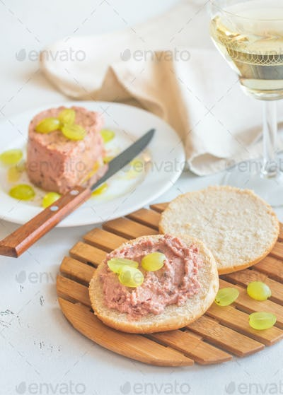 Slice of bread with pate on the wooden board