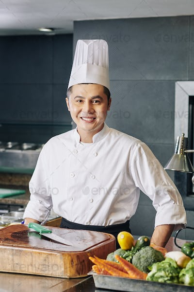 Asian successful chef in the kitchen