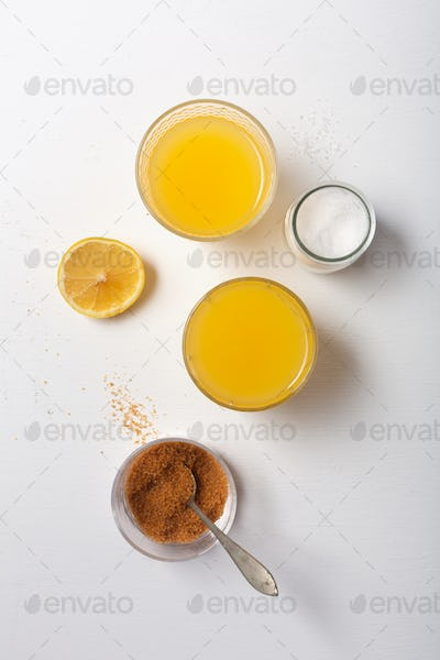 Homemade Isotonic Energy Drink and Ingredients. Glasses With Yellow Liquid, Homemade Sport Beverage