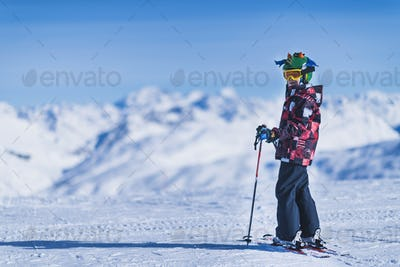 Skiing Boy on a Mountain Top