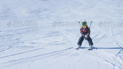 Young Skier Skiing Down the Slope