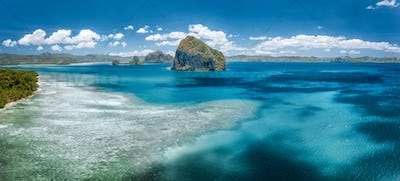Aerial view of amazing tropical sea water colors near in El Nido, Palawan, Philippines