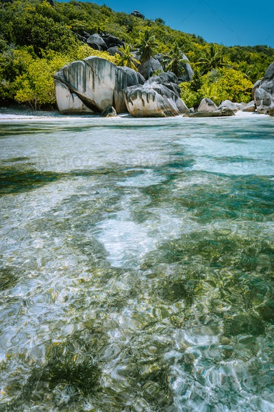 Anse Source d'Argent - Paradise tropical beach. Shallow lagoon on tide, Granite boulders and