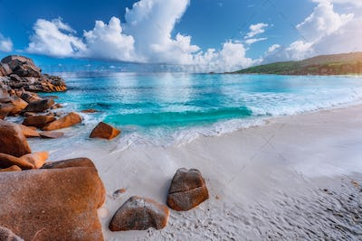 Impressive clouds above crystal clear ocean and beautiful tropical beach. Seychelles Grand Anse, La